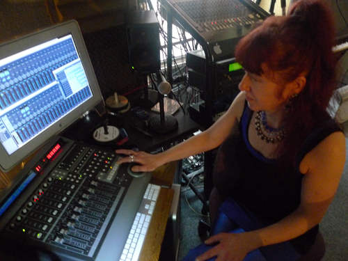 studio engineer kirsty at the controls